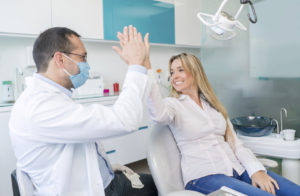 woman happy at dentist