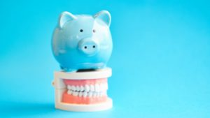 Piggy bank on top of model teeth
